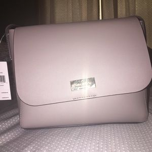 Brand new with tags Kate Spade purse.